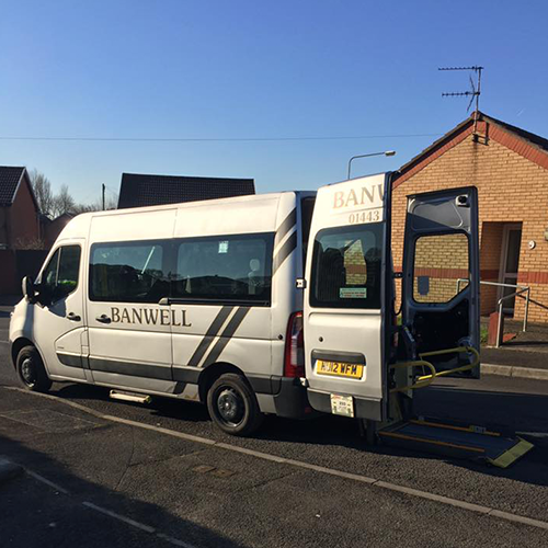 An image of a minibus with a wheelchair ramp.